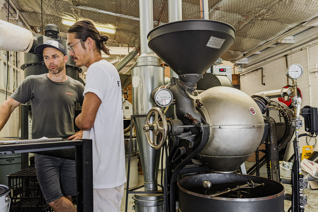 Takumi roasting on Barth ball roaster at Sample coffee