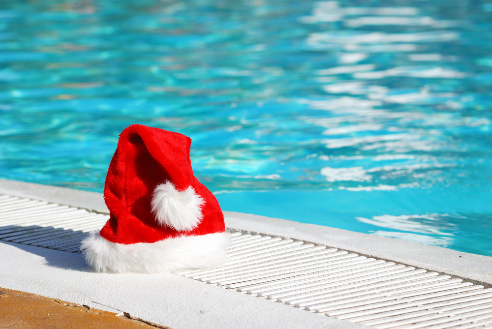 Santa Hat by Swimming Pool Christmas Day Swim