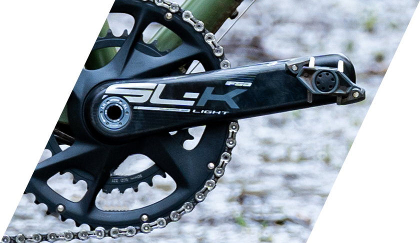 image of an SLK crankset on a green bicycle frame
