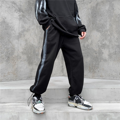 Japanese trendy men's side bars and feet sports trousers