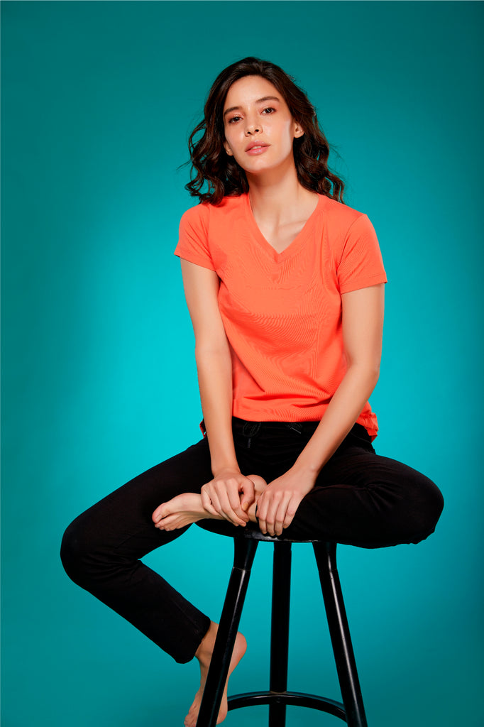 Front Side Cotton Tapered Fit Black Track Pant For Women With Orange T-Shirt
