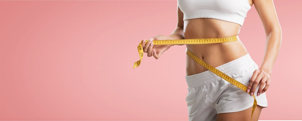 stock image woman measuring her stomach