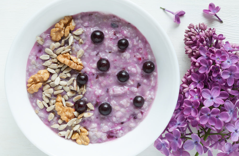 Purple porridge with blueberries, seeds and nuts
