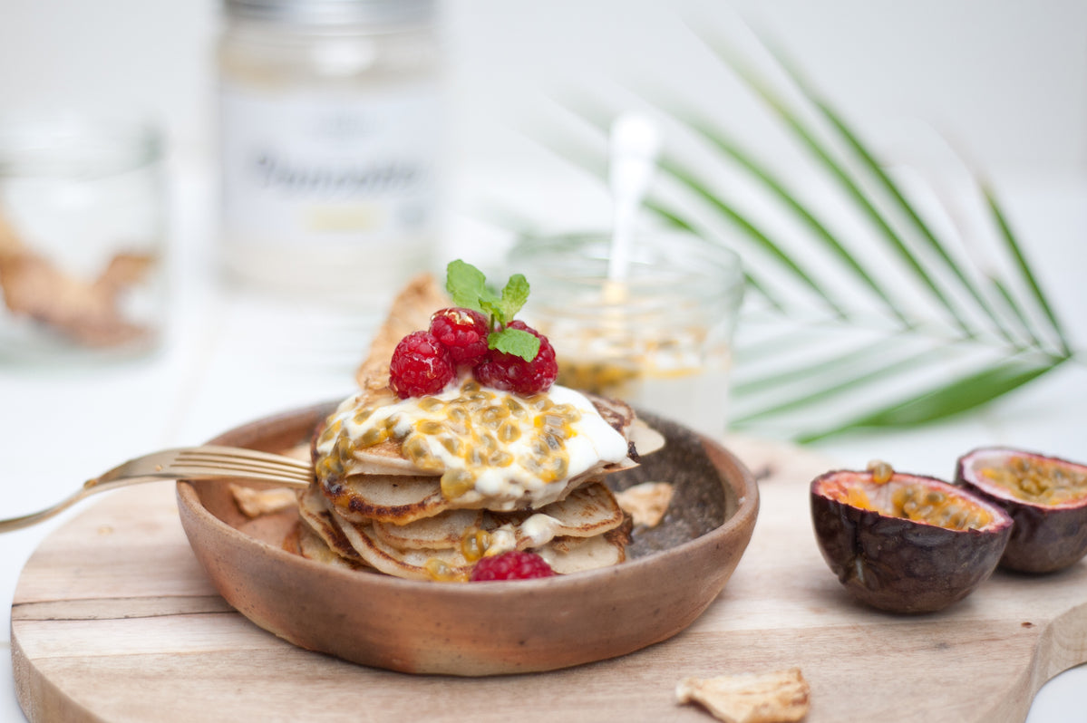 tropical pancakes with yoghurt, passionfruit and raspberries