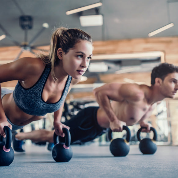 Man and woman working out in the gym