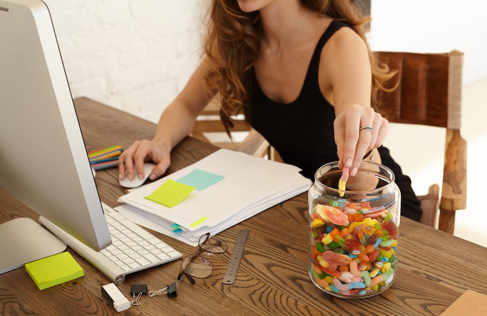 woman eating sweets working from home