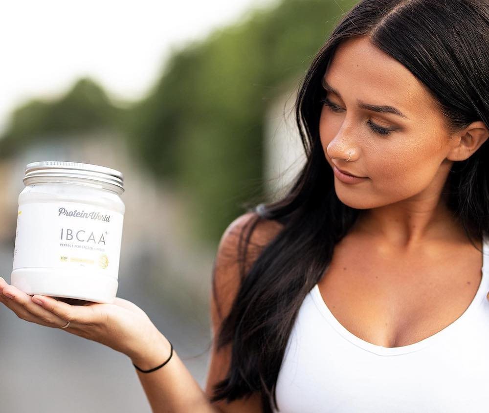 girl holding old tub of ibcaa