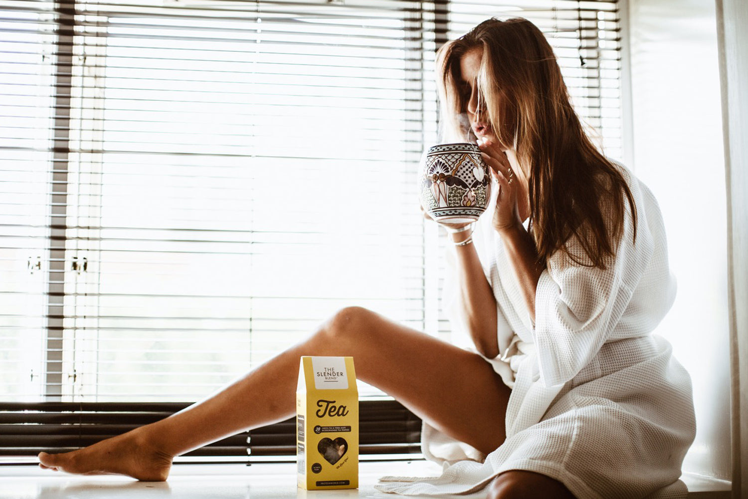 Girl with Slender tea sitting by window