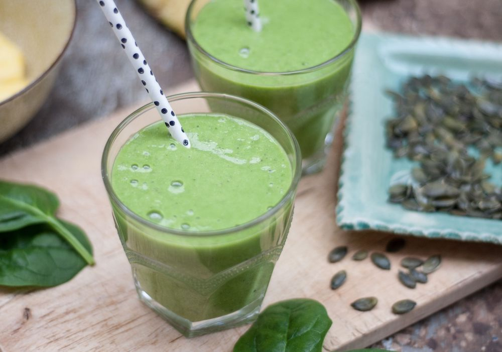 Green smoothie with straw