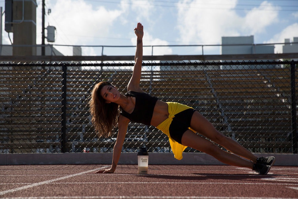 Woman doing plank on track