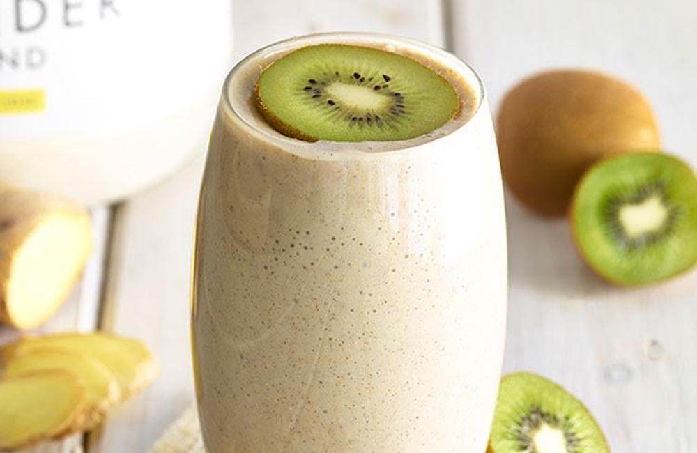 Glass of smoothie with slice of kiwi on top