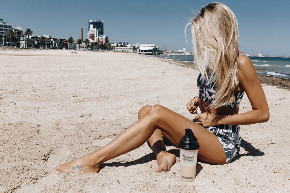 Woman on beach with Slender Blend
