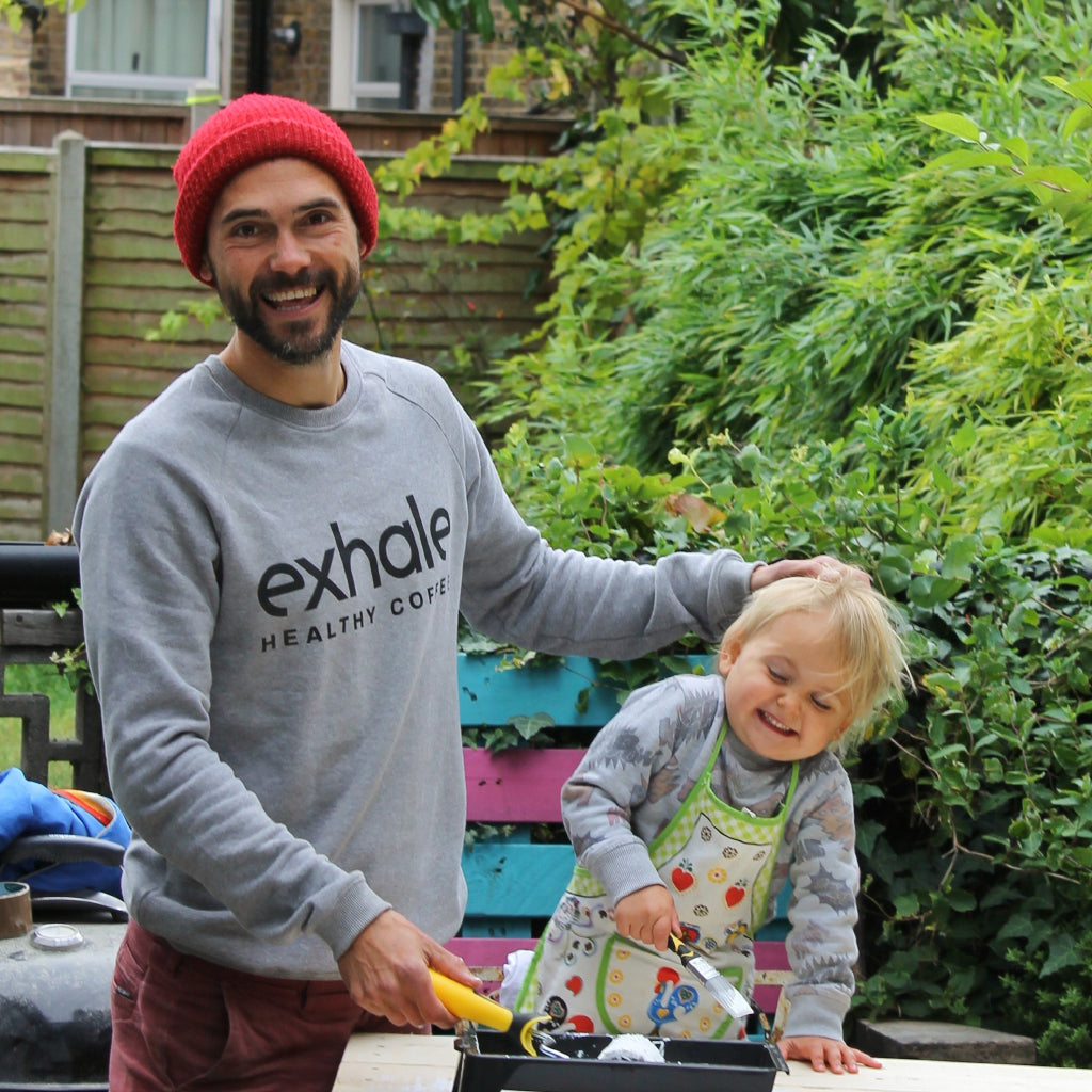 Founder Al with his daughter and exhale sweatshirt in garden