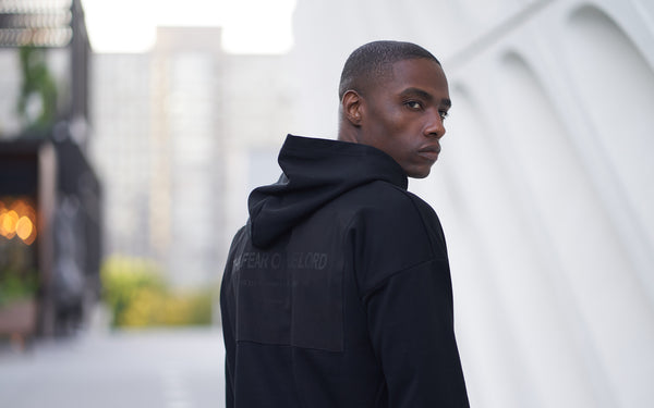 A man wearing black Christian Hoodie