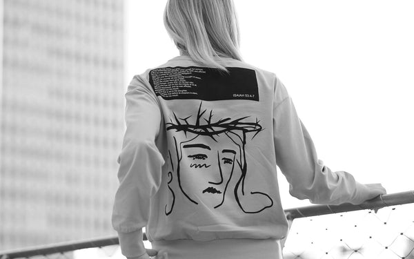 A woman wearing Christian sweatshirt, Crucifixion of Christ printed