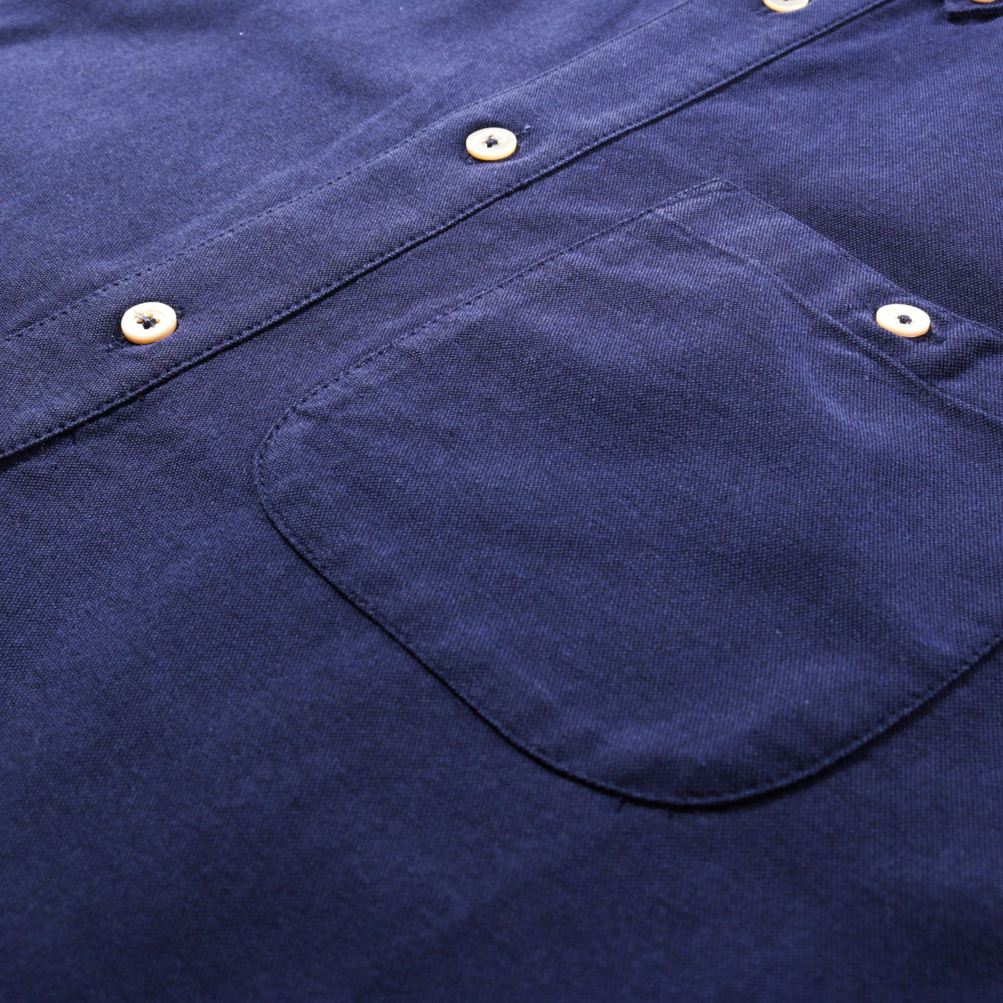 A KIND OF GUISE PERMANENTS BUTTON DOWN OXFORD INDIGO