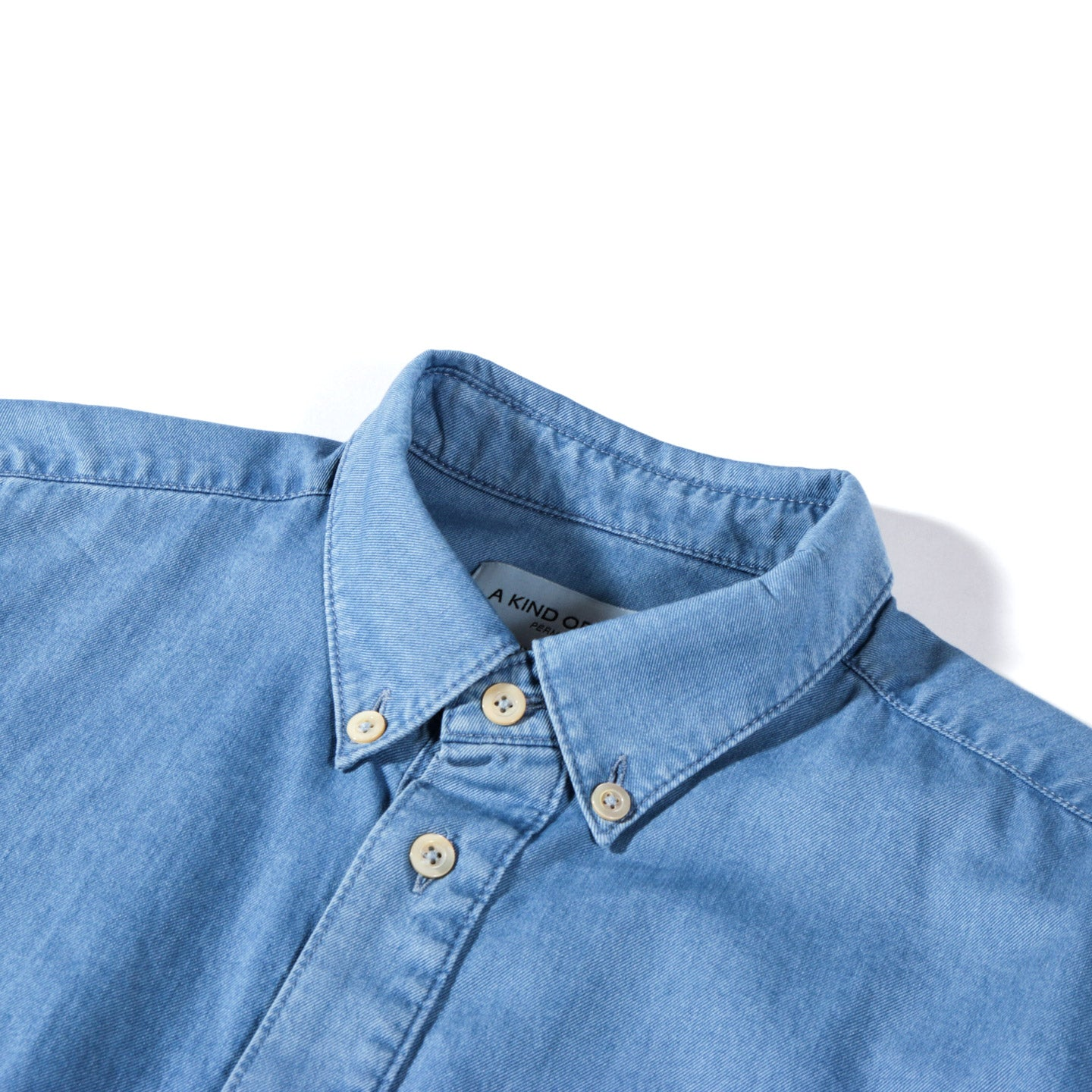 A KIND OF GUISE PERMANENTS BUTTON DOWN BLEACHED DENIM