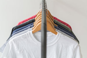 "alt=""Tee shirt white color brands apparel hanging"">"