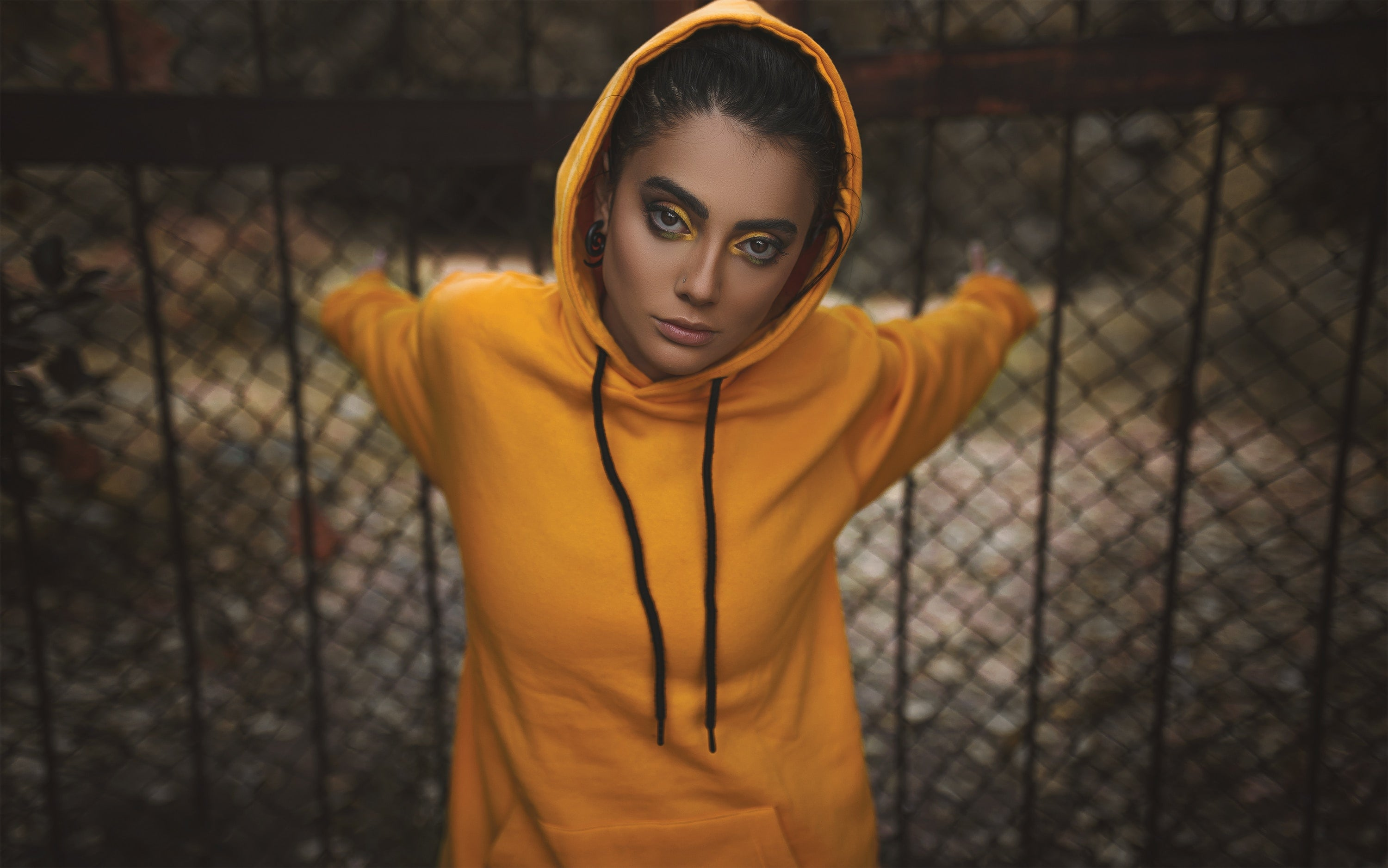 Yellow hoodie worn by a woman