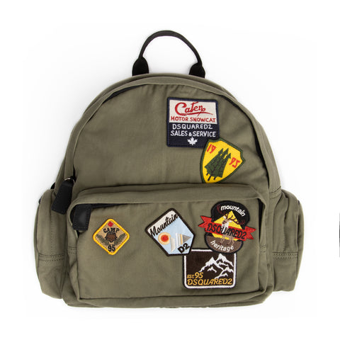 Green military backpack with patches