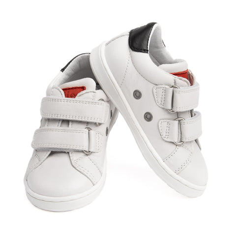 White sneaker with red heart