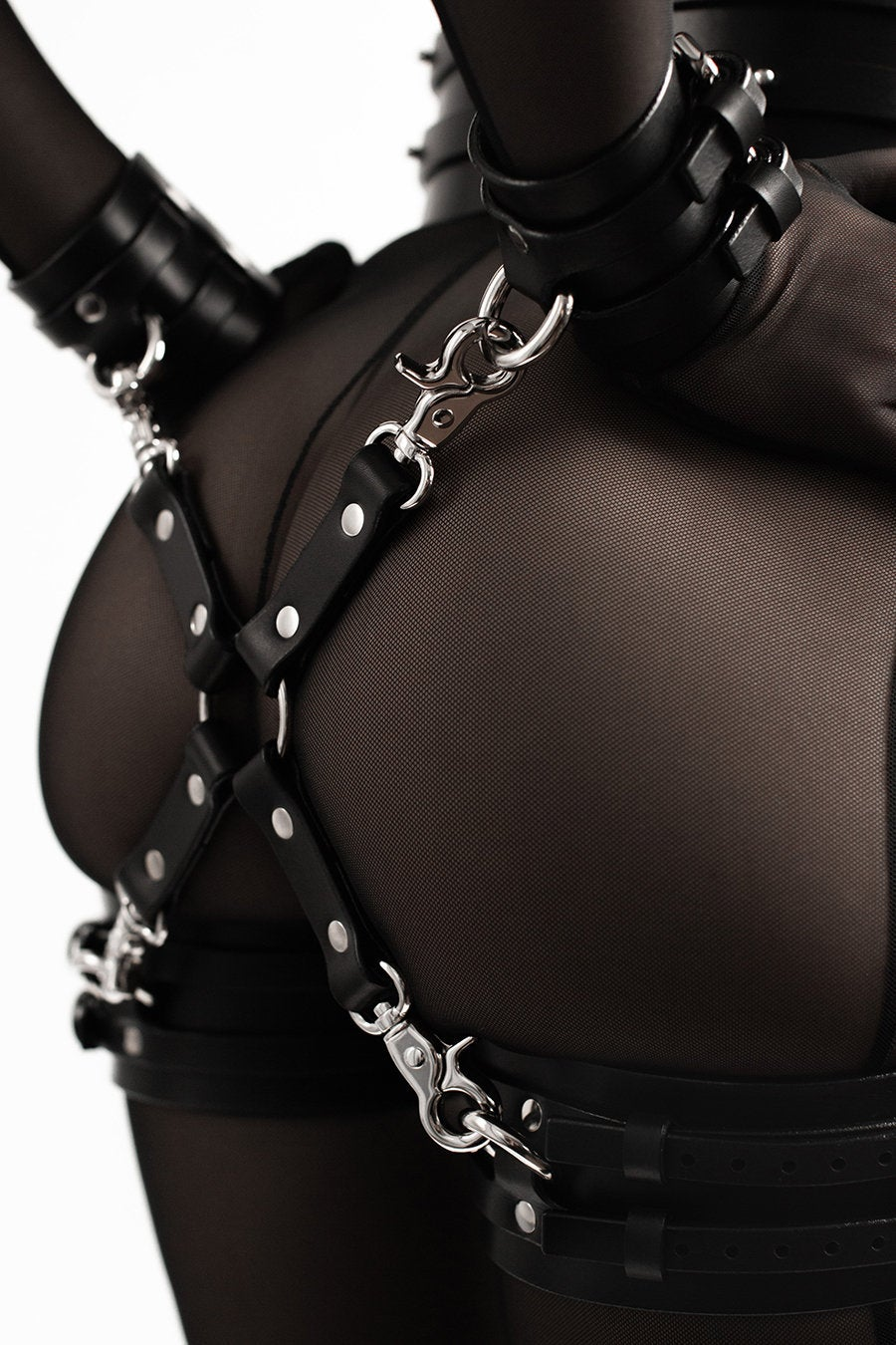 BDSM handcuffs and thigh cuffs