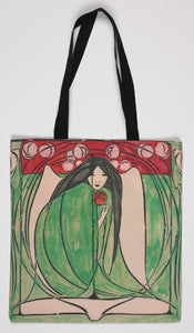 Long handled tote bag showing an illustration of a woman in a green dress, crouched, clutching a red flower with black handles.