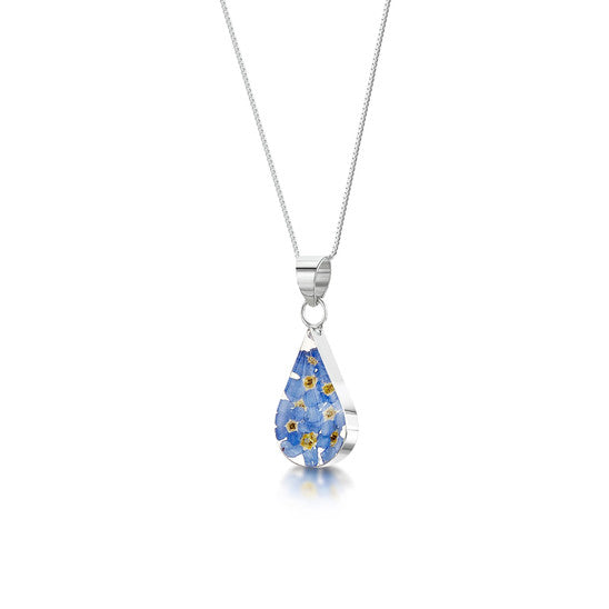 Necklace with a teardrop shaped pendant of resin encasing forget me not flowers on a silver chain.