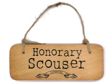 Hanging wooden sign with the phrase honorary scouser on it.