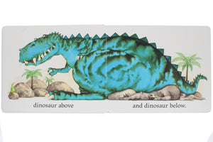 Inside double page spread of book showing a large blue dinosaur sat on a smaller dinosaur