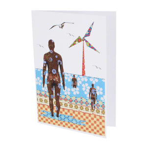 Greeting card showing a stylised illustration of Crosby beach in Tula Moon's distinctive bright patchwork style.