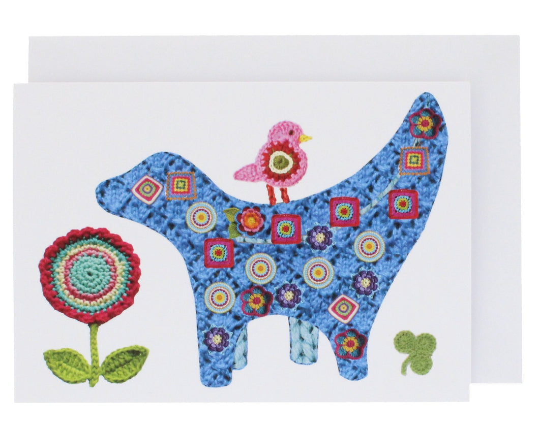 Greeting card featuring a knitted version of the Super Lambanana, a statue that is half Lamb and half Banana.
