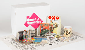 Branded House of Memories box, shown behind it's laid out contents. Containing household memorabilia.