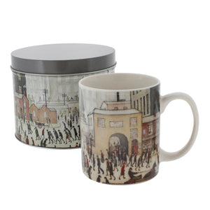 Mug printed with Lowry's Coming From the Mill, shown in front of a circular tin printed with the same image with a matching grey lid.