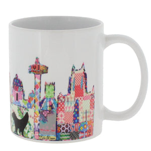 Ceramic mug featuring Liverpool's skyline in Tula Moon's distinctive bright patchwork style.
