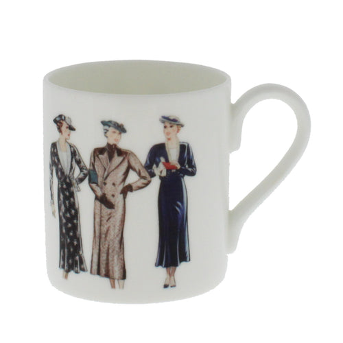 White china mug showing illustrations of three well dressed women.