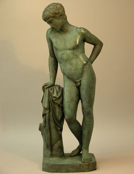 Bronze sculpture showing mythical figure Narcissus leaning on a short pillar and gazing at something.