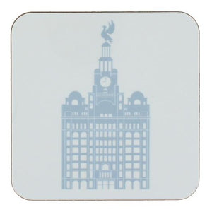 Square coaster with rounded edges showing an illustration of the liver building in light blue on a white background