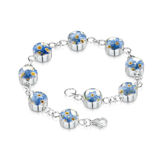 Bracelet made up of circles of resin with forget me not flowers joined by silver chain.