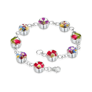 Bracelet composed of a silver chain with interspersed clear resin with flowers set in it.