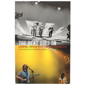Front cover of The Beat Goes On, showing two different music groups playing on stage.