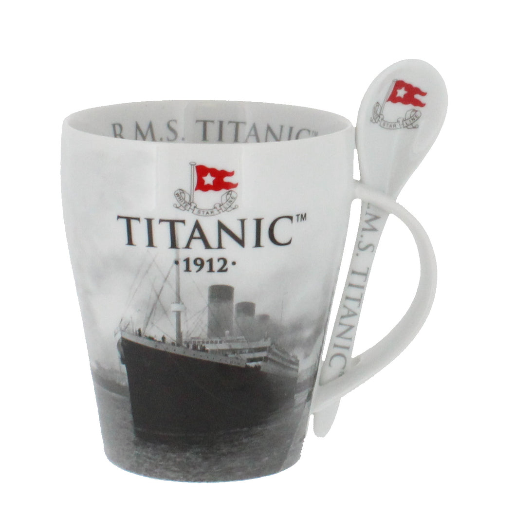 Mug with a spoon slotted in to handle, showing the Titanic sailing.