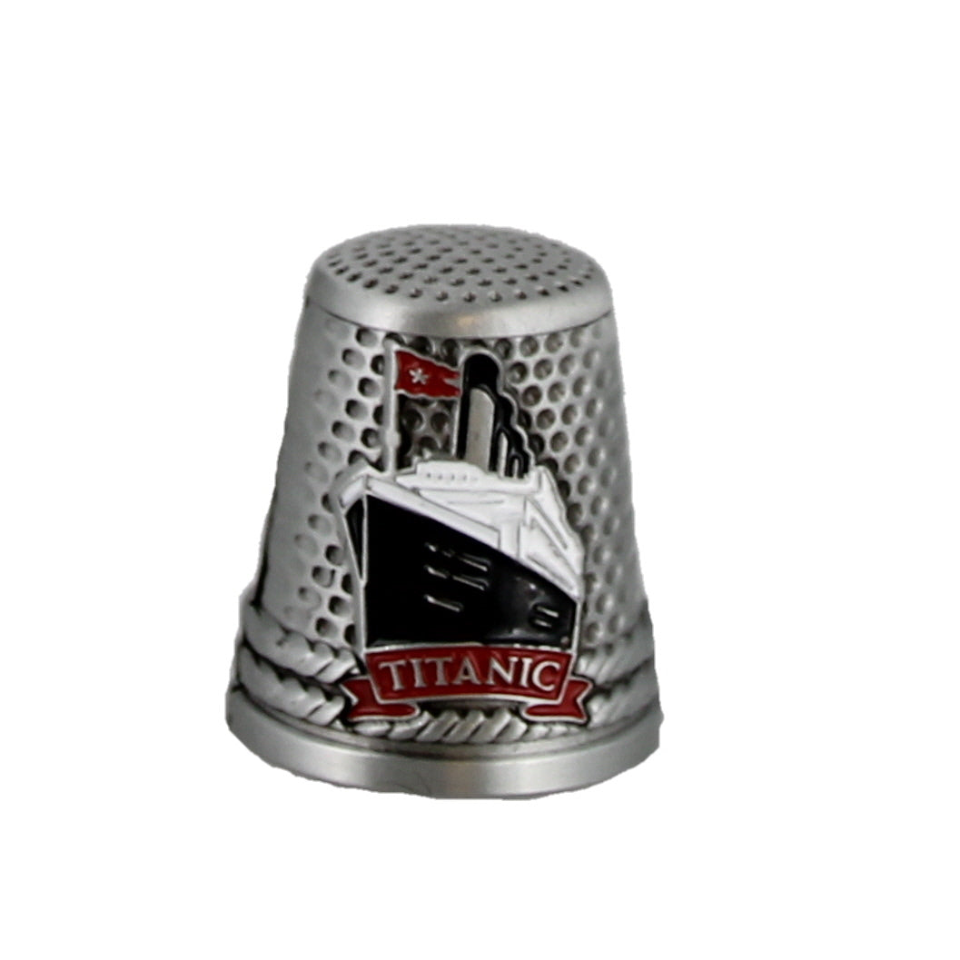 Silver coloured thimble with enamel image of the Titanic ship on the front.