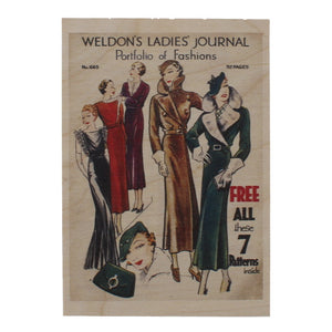 Standard sized postcard made of light wood, printed with a reproduced magazine cover, showing illustrations of several well dressed women