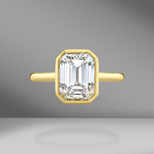 Bezel Set Yellow Gold Emerald Cut