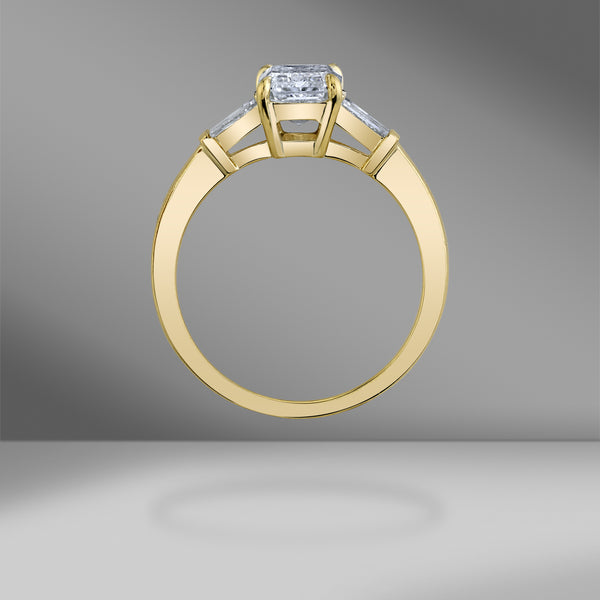3 Stone Emerald Cut Engagement Ring in Yellow Gold