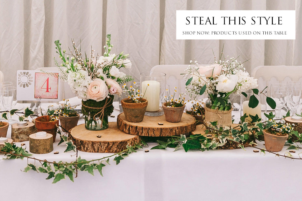 rustic woodland wedding table styling tree slices log tea light holders moss