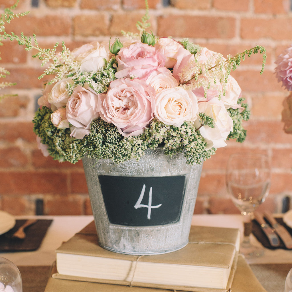 Blackboard bucket wedding centrepiece the wedding of my for Floral table decorations for weddings
