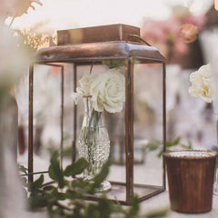 Vases placed in brass lanterns wedding centrepieces available from @theweddingomd The Wedding of my Dreams