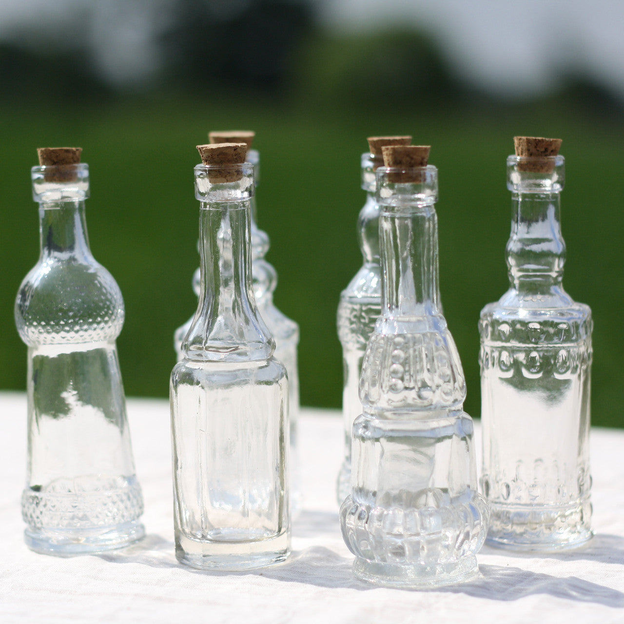 set of 6 glass bottle vases with cork stoppers pre order for